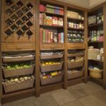 Warm Cognac Pantry with Rattan Baskets and Decorative Trim